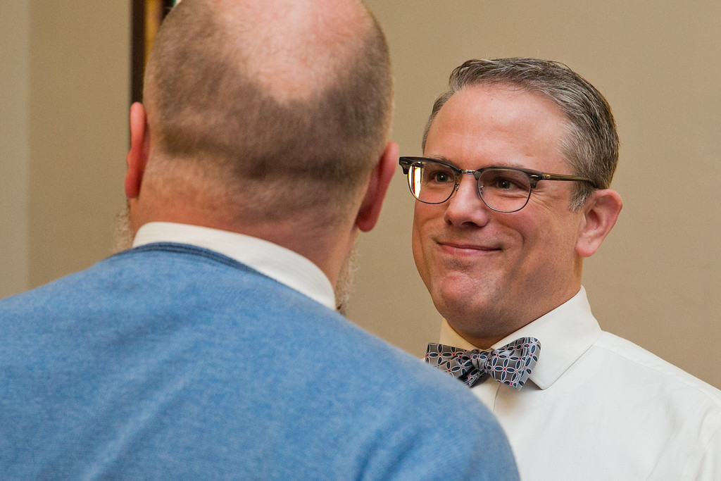 Description of . Art Ledin-Bristol smiles at his soon-to-be-husband, Corey Ledin-Bristol, during their wedding ceremony at the Harbor Unitarian Universalist church in Muskegon, Mich., on Saturday, March 22, 2014. (AP Photo/The Chronicle, Natalie Kolb)