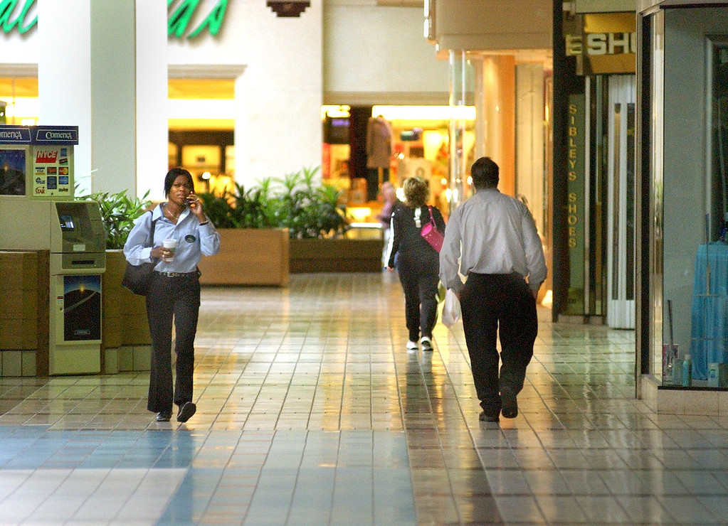 Description of . Customers at the  Summit Place Mall in Waterford Township.