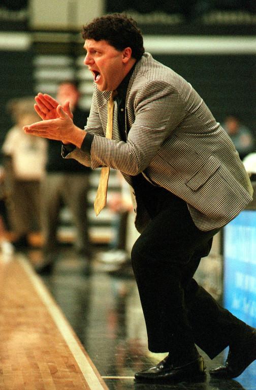 Description of . Oakland University mens basketball head coach Greg Kampe.
