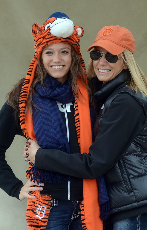 Description of . Olivia Hale (left) and Melanie Olson, both of Lake Orion, have their picture taken in front of Comerica Park before heading inside for the start of Game 3 of the ALDS between the Tigers and Oakland A's, Monday October 7, 2013. (Oakland Press Photo:Vaughn Gurganian)
