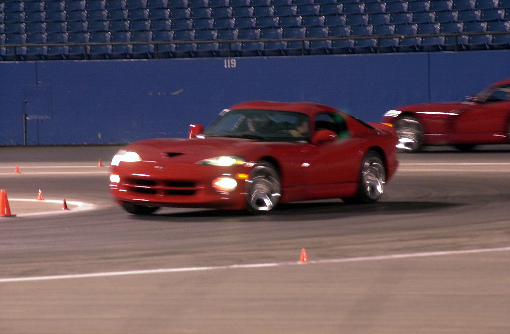 Description of . Chrysler employees and family members had a chance to drive in a new 2001 Dodge Vipers around a race track setup inside the Silverdome. The whole setup at the Silverdome is a trial run getting ready for the Daytona 500.