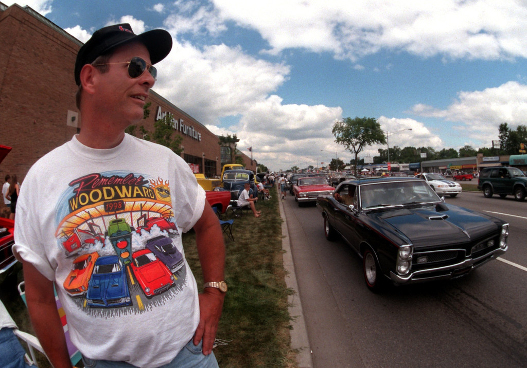 Description of . Dale Buxton of Canton Ohio watches classic cars stream down Woodward Ave. in Royal Oak during the Fifth Annual Woodward Dream Cruise.