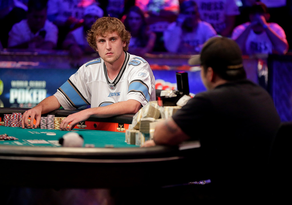 Description of . Ryan Riess, left, waits for a play from Jay Farber during the World Series of Poker final table, Tuesday, Nov. 5, 2013, in Las Vegas. (AP Photo/Julie Jacobson)