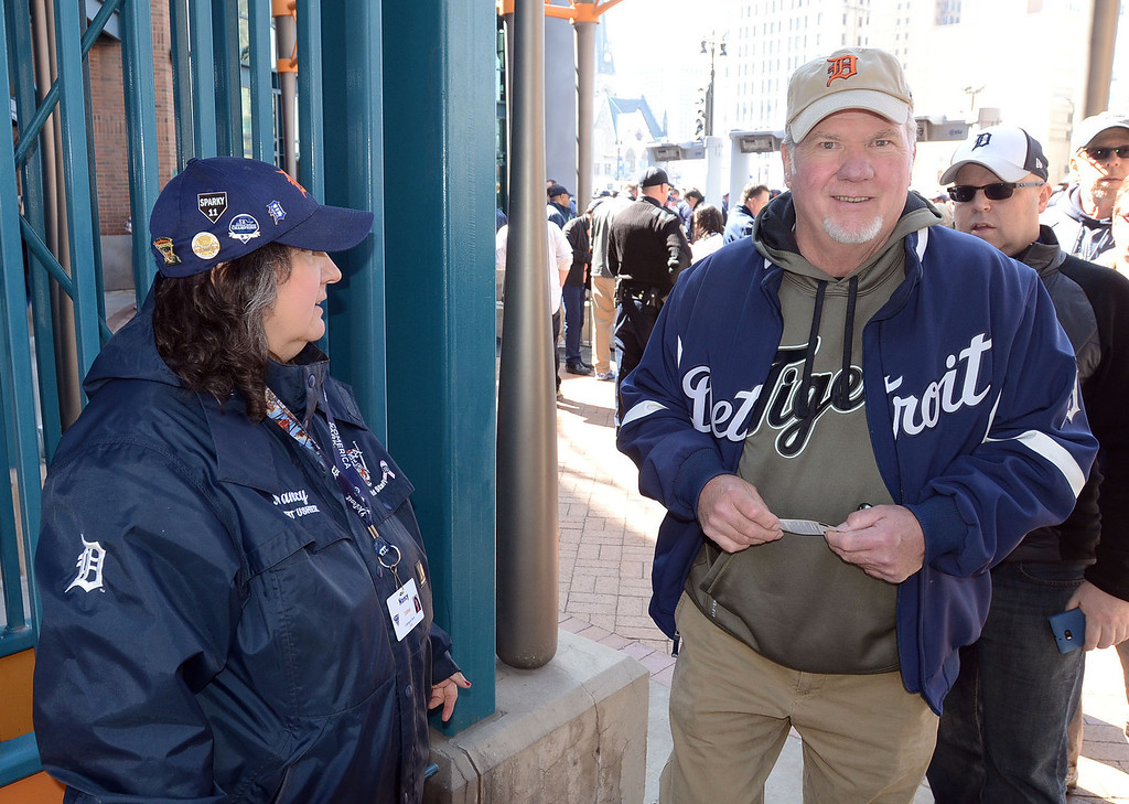 Description of . Don McGraw, of Springfield Twp., enters Comerica Park for the Tigers home opener game against Kansas City, pictured Monday March 31, 2014. This is Don's 43rd Opening Day he's attended for the Tigers. (Vaughn Gurganian-The Oakland Press)