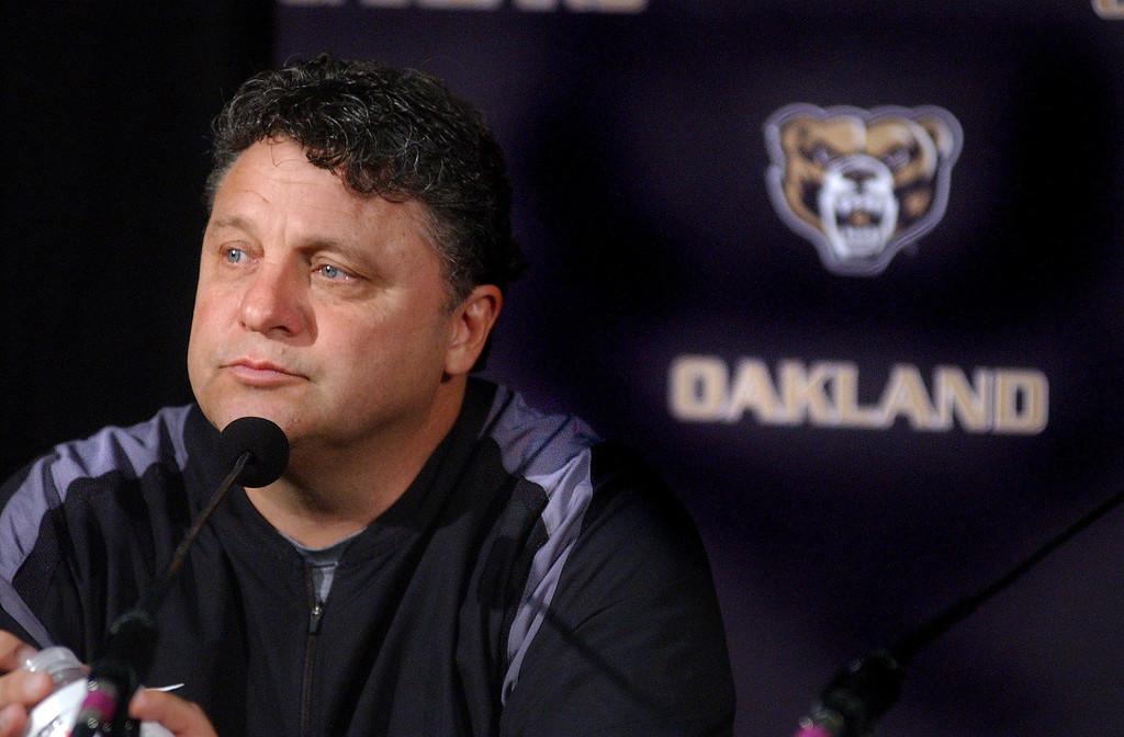 Description of . Oakland University's men's basketball coach Greg Kampe during media day practice. The Oakland Press/TIM THOMPSON