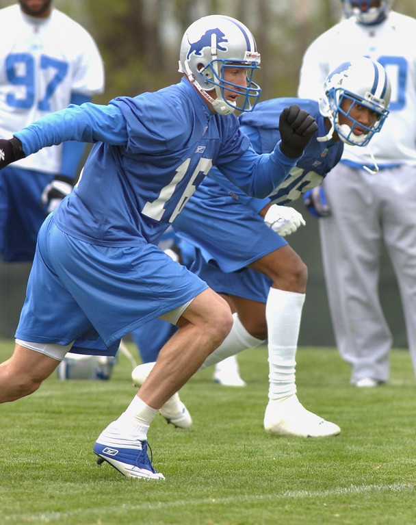 . Detroit Lions wide receivers Bill Schroeder (left, #16) and Scotty Anderson (#88) prepare to run their routes during mini-camp, Saturday, April 26, 2002, in Allen Park, Mich.