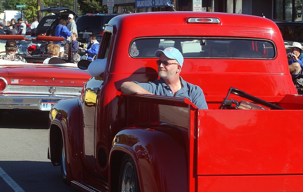 Description of . Dale Paggon, of Livonia, enjoys the view from the back of a 1953 Ford F-100 truck while cruising along Woodward Ave. in Royal Oak during the 2004 Woodward Dream Cruise, Saturday August 21, 2004.