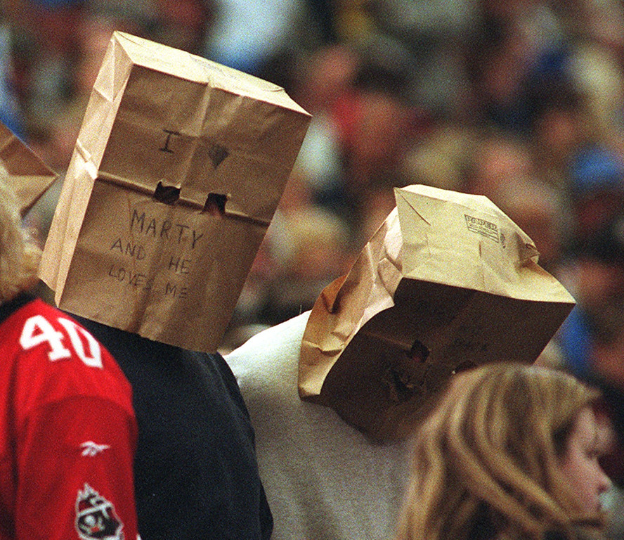 Description of . A few Lions fans bring out their paper bags to wear  during Tampa Bay's 20-17 win over the Detroit Lions at the Pontiac Silverdome Sunday.