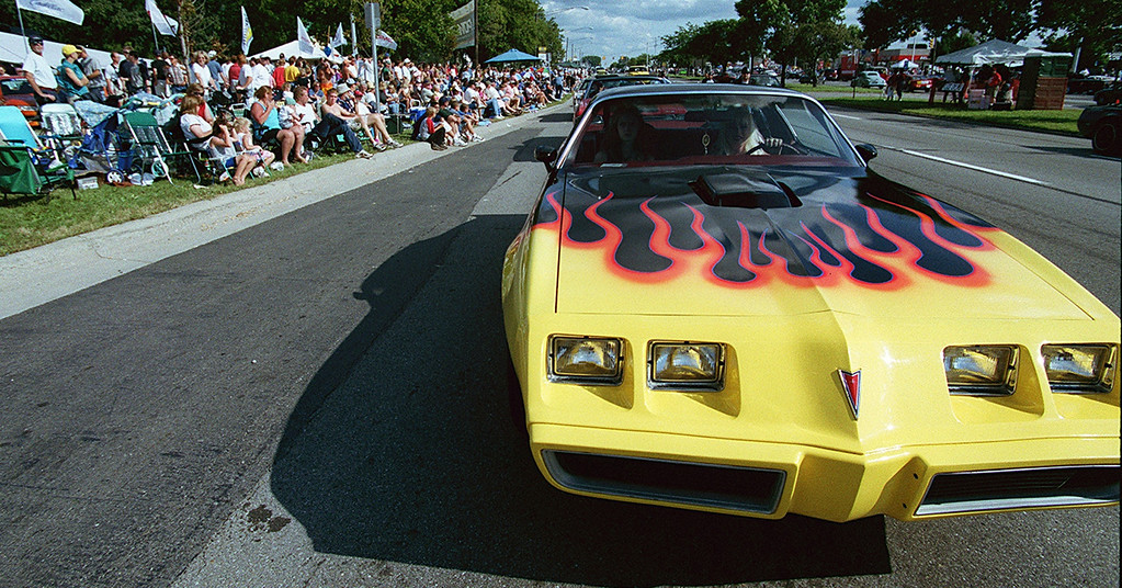 . Denise Downen drives her 1979 Firebird up Woodward as thousands oggle the vintage cars during the Dream Cruise 2000 saturday afternoon.
