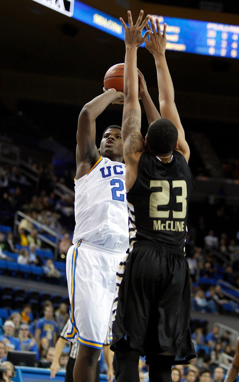 Description of . UCLA center Tony Parker, left, shoots over Oakland forward Tommie McCune in the second half of their NCAA college basketball game Tuesday, Nov. 12, 2013, in Los Angeles. UCLA won the game 91-60.  (AP Photo/Alex Gallardo)