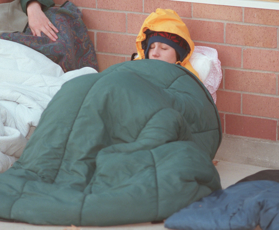 Description of . Freshman Michelle Vantrump, 19, trying to stay warm early Tuesday morning. Students line up overnight for basketball tickets at Oakland University's new sports arena. Oakland University is becoming a division 1 school, and the highly rank MSU Spartans will be their first home opponent. Vantrump had been in line since 11 p.m. the previous night.