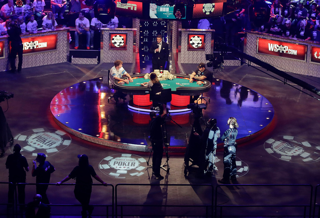 Description of . Ryan Riess, left, and Jay Farber continue play as the two remaining finalists during the World Series of Poker final table, Tuesday, Nov. 5, 2013, in Las Vegas. (AP Photo/Julie Jacobson)