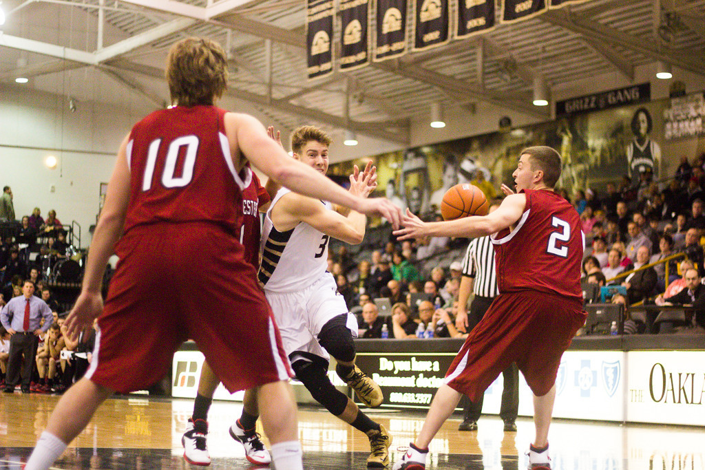 Description of . A Rochester College player steals the ball from Bader. Photo by Dylan Dulberg