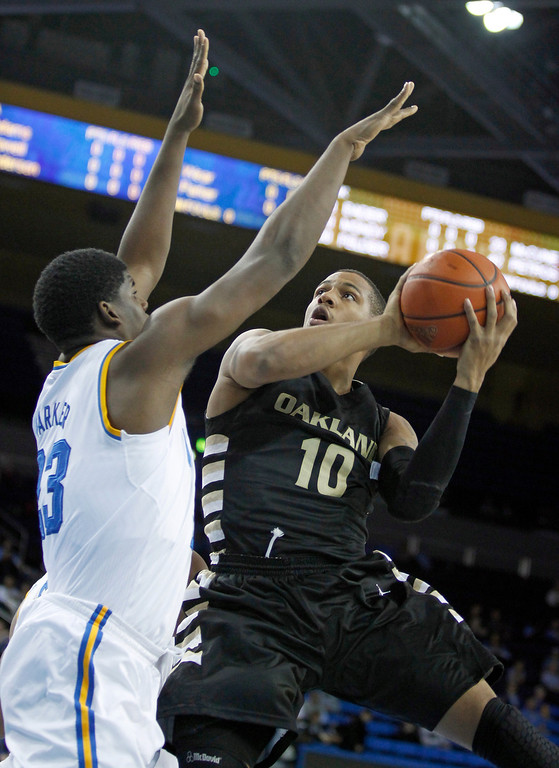 Description of . Oakland guard Duke Mondy (10) shoots over UCLA center Tony Parker (23) during the first half of an NCAA college basketball game Tuesday, Nov. 12, 2013, in Los Angeles. (AP Photo/Alex Gallardo)