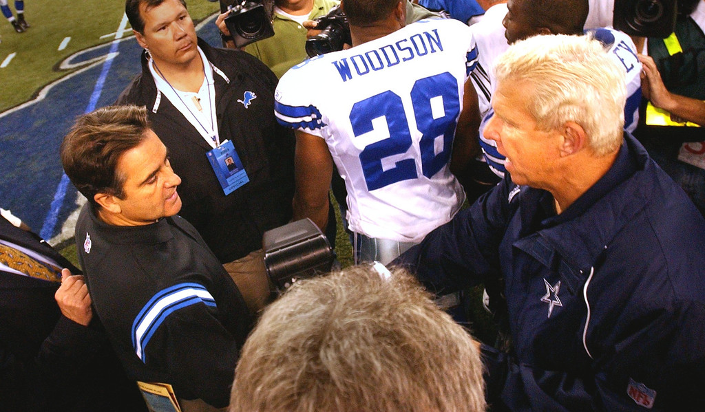 . Detroit Lions Head Coach, Steve Mariucci and Dallas Cowboys Head Coach Bil Parcells, meet after their game on sunday.The Cowboys beat the Lions 38-7  at Ford Field in Detroit.  October 19, 2003