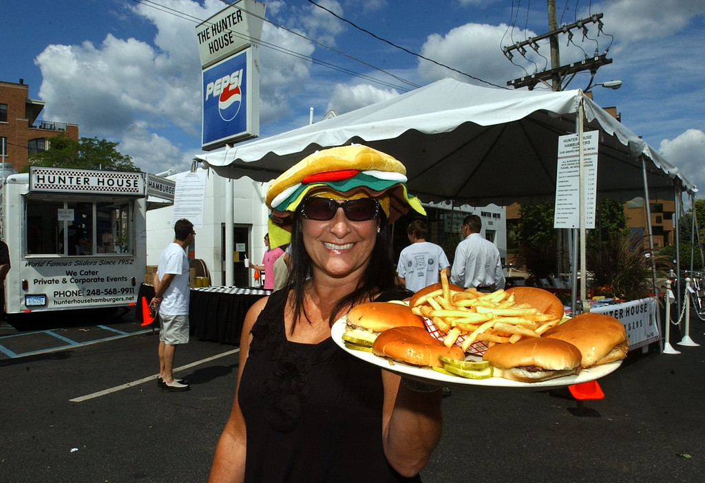 Description of . Susan Cobb, owner of Hunter House Hamburgers in Birmingham, plans on selling lots of their famous sliders during the Woodward Dream Cruise. (Oakland Press Photo: Vaughn Gurganian)