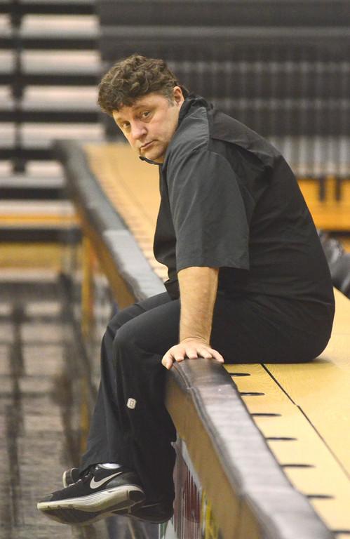 Description of . Oakland University head coach Greg Kampe during practice Tuesday.    Tuesday, November 5, 2013.  The Oakland Press/TIM THOMPSON