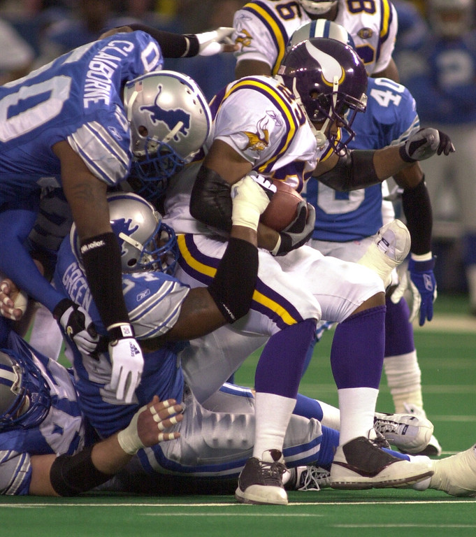. Detroit Lions defense swarms around the Vikings  running back Michael Bennett during first half action in the Lions 27-24 win over the Minnesota Vikings at the Pontiac Silverdome Sunday December 16, 2001.