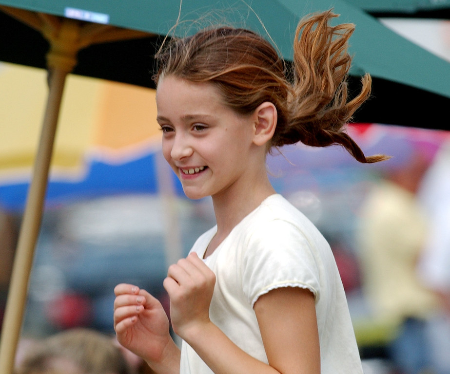 . Katie O\'Rear, age 12, of Ferndale, Mich., jumps up and down after a motorist revved his engine for the crowd during the Dream Cruise.  Photo taken on Saturay, August 20, 2005, in Royal Oak, Mich.