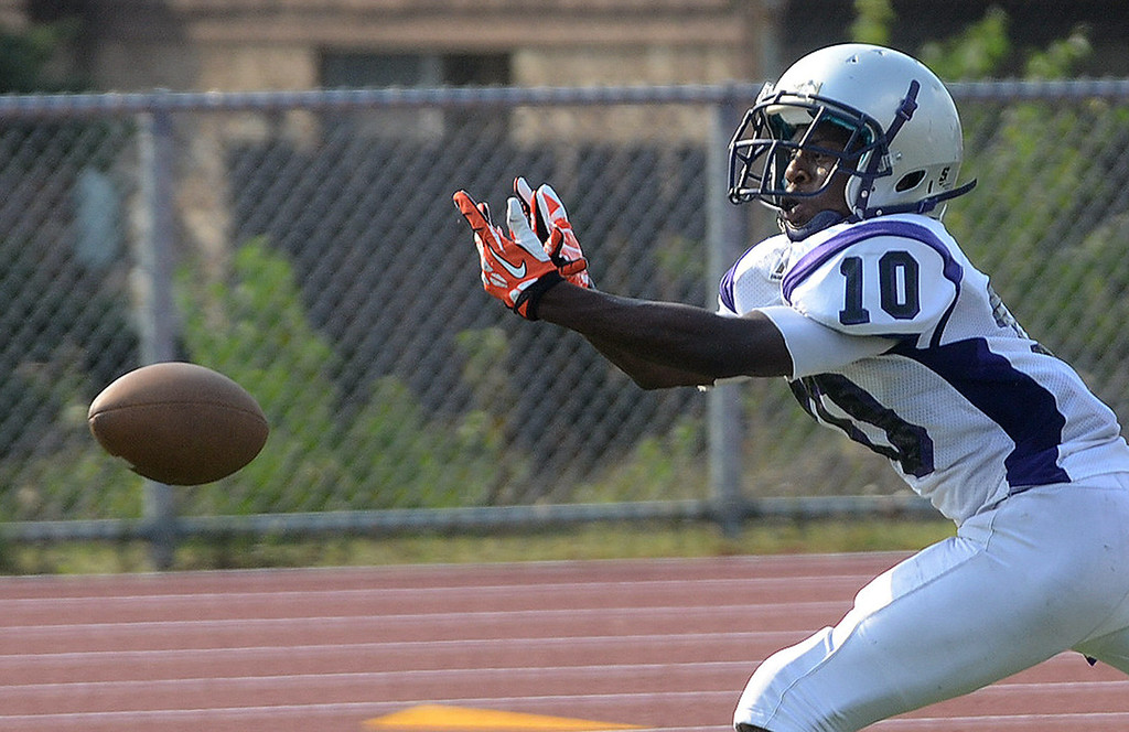 Description of . Pontiac High School wide receiver #10 Jamal Champele can't catch up to this pass in the end zone during their game against Southfield-Lathrup at Southfield Lathrup High School, Thursday August 29, 2013. (Oakland Press Photo:Vaughn Gurganian)