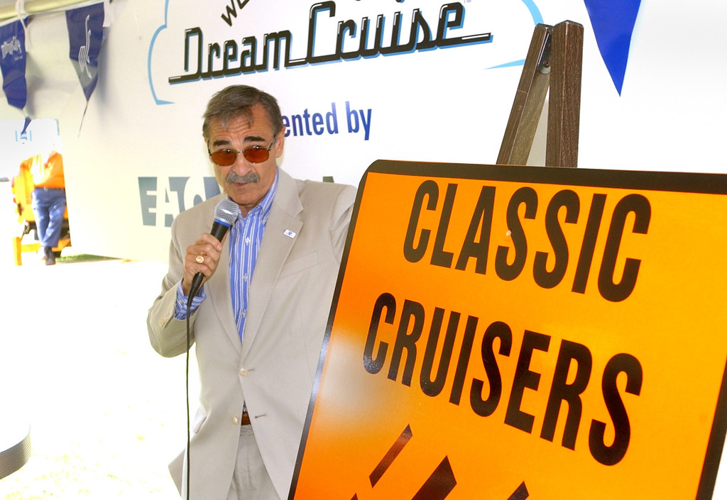 Description of . WOMC\'s Dick Purtan MC\'s the kickoff luncheon of the 10th annual Woodward Dream Cruise, on Woodward between 13 and 14 Mile roads in Royal Oak.
