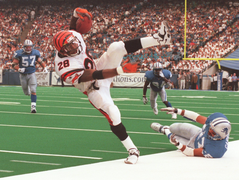 . Detroit Lions  Mark Carrier (27) up ends Cincinnati Bengal Corey Dillion (28) early in the first qurter during Sunday\'s game played against the Cincinnati Bengals at the Pontiac Silverdome. Lions lost 34- 28 in overtime.