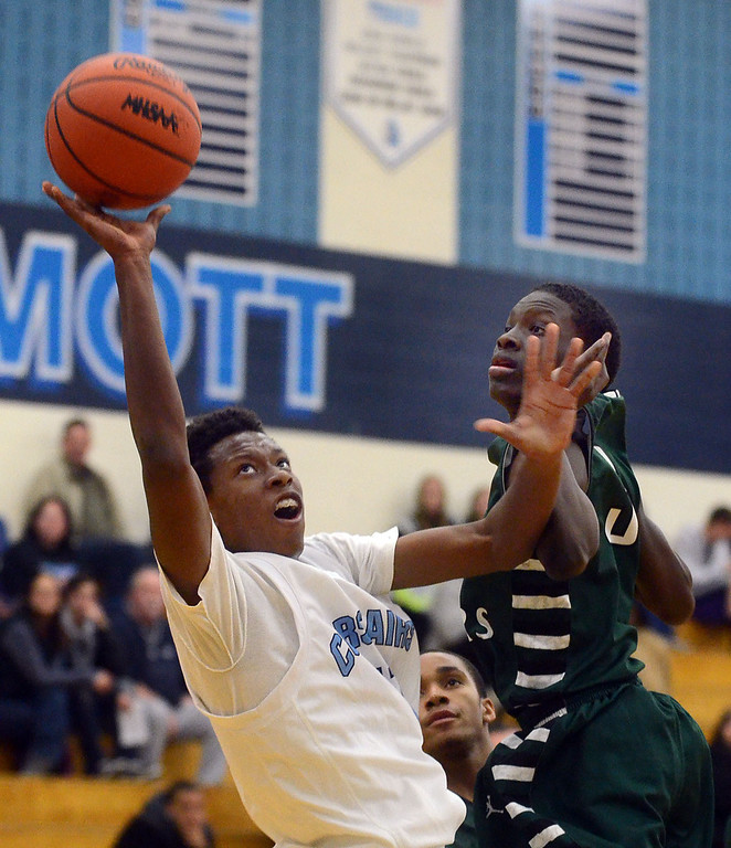 Description of . Waterford Mott's #11 Austin Sherrell puts up a shot while drawing the foul from West Bloomfield's #3 Mitchell Bailey during their game at Waterford Mott High School, Thursday December 12, 2013. West Bloomfield went on to win the game 55-52. (Vaughn Gurganian-The Oakland Press)