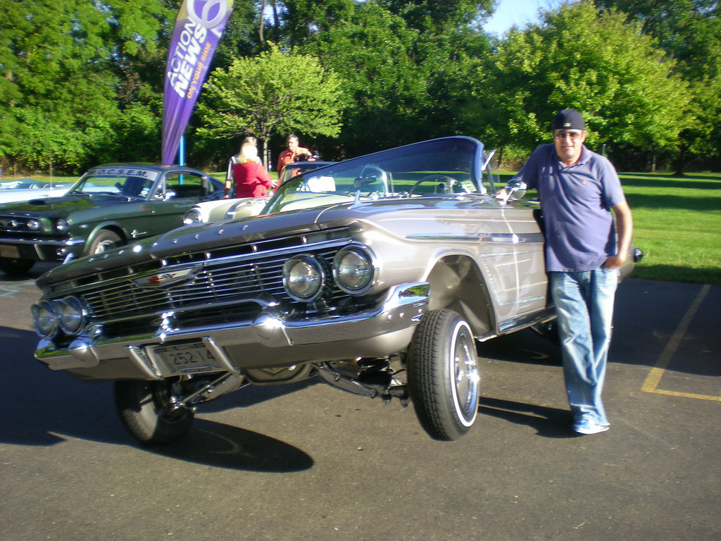 Description of . Marc Benkoff's 1961 Chevy Impala low rider caught everyone's eye at a gathering of the Woodward Dream Cruise board Monday at WXYZ-TV in Southfield. The board members said everything is ready to go for the big Dream Cruise on Saturday.