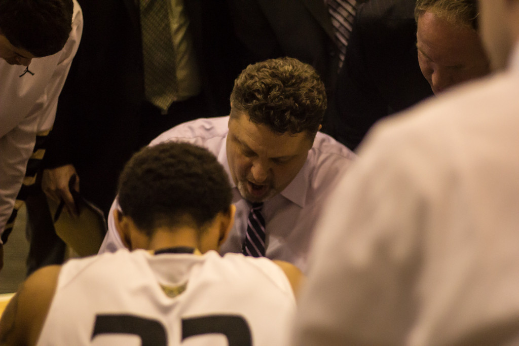 Description of . Oakland University Head Coach Greg Kampe during a timeout. Photo by Dylan Dulberg/The Oakland Press