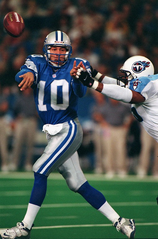 . Under pressure from Tennessee Titan LB Eddie Robinson (right), Detroit Lions Quarterback Charlie Batch throws a pass during the Lions 27-24 loss at the Pontiac Silverdome Sunday.  Batch had 338 yards passing in the loss.