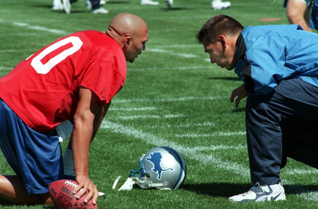 . Detroit Lions quarterback Charlie Batch chats with quarterback coach Jim Zorn.