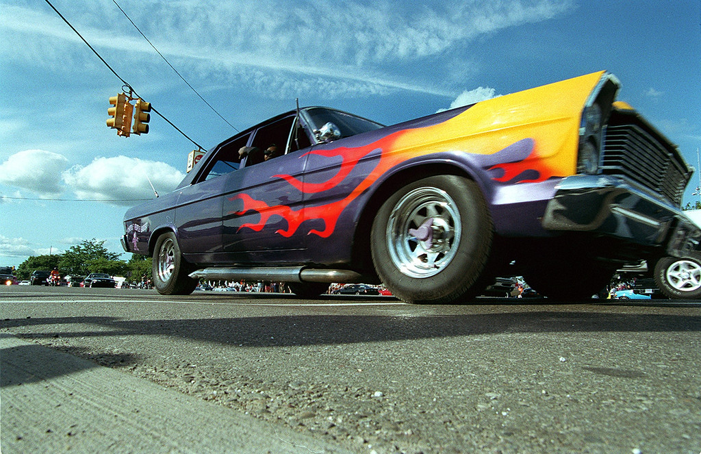 Description of . A flame painted car called the Purple People Eater burns rubber on southbound Woodward at 13 mile during the Dream Cruise 2000 saturday afternoon.