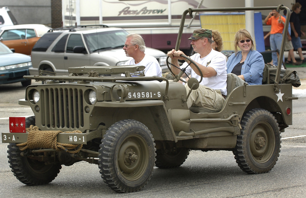 Description of . The Woodward Dream Cruise is a great time to bring out all types of vehicles, including old military Jeeps, as seen here Saturday afternoon on the loop in Pontiac.