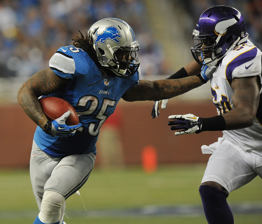 . Detroit Lions running back Mikel Leshoure, left, runs for yardage as he pushes back Minnesota Vikings linebacker Jasper Brinkley during fourth quarter action.  The Vikings beat the Lions 20-13.  Photo taken on Sunday, September 30, 2012, at Ford Field in Detroit, Mich.  (Special to The Oakland Press/Jose Juarez)
