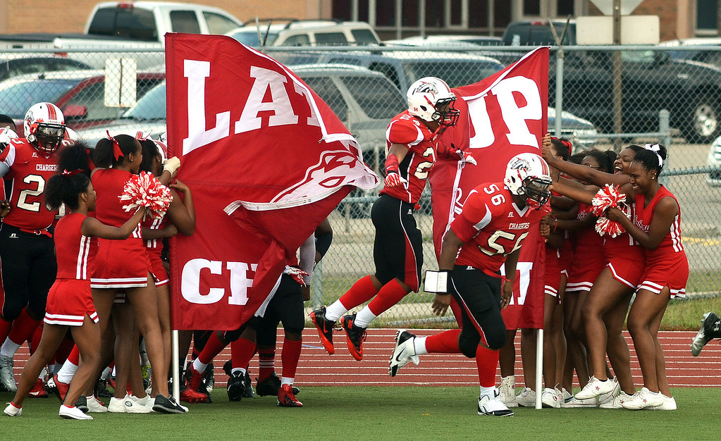 Description of . Southfield-Lathrup takes the field prior to the start of their game against Pontiac High School, at Southfield Lathrup High School, Thursday August 29, 2013. (Oakland Press Photo:Vaughn Gurganian)