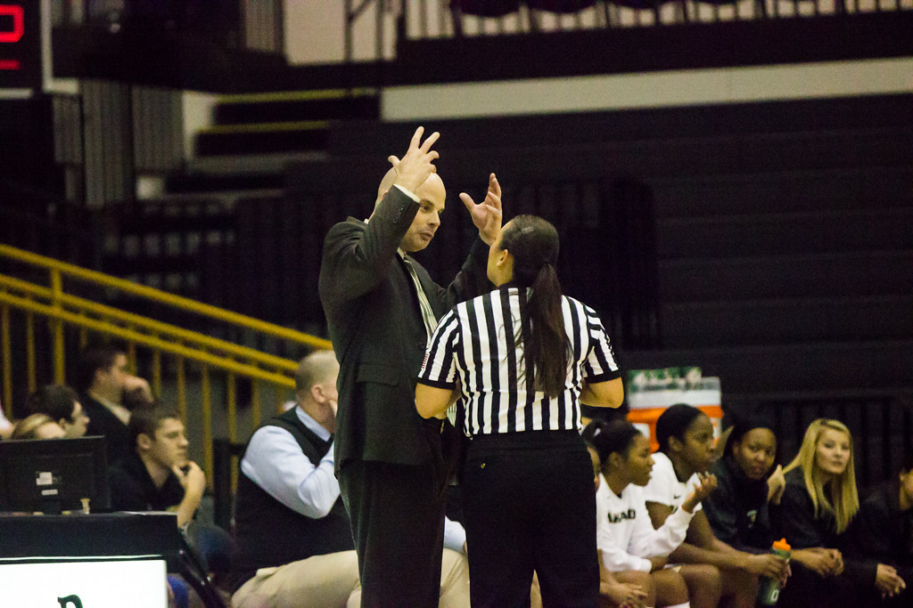 Description of . Coach Jeff Tungate discusses a call with the referee. Photo by Dylan Dulberg