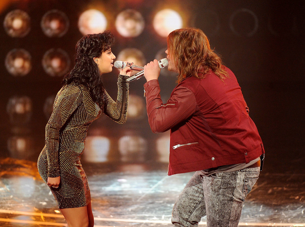 Description of . AMERICAN IDOL XIII: L-R: Jena Irene and Caleb Johnson perform on AMERICAN IDOL XIII airing Wednesday, April 9 (8:00-10:00 PM ET / PT) on FOX. CR: Frank Micelotta / FOX. Copyright 2014 / FOX Broadcasting.