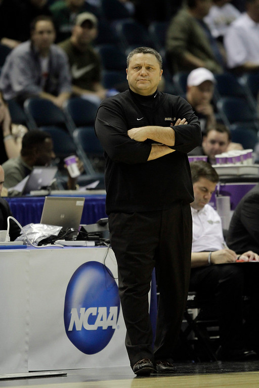 Description of . Oakland's coach Greg Kampe against Pittsburgh in the second half of an NCAA first-round college basketball game in Milwaukee, Friday, March 19, 2010.(AP Photo/Morry Gash)