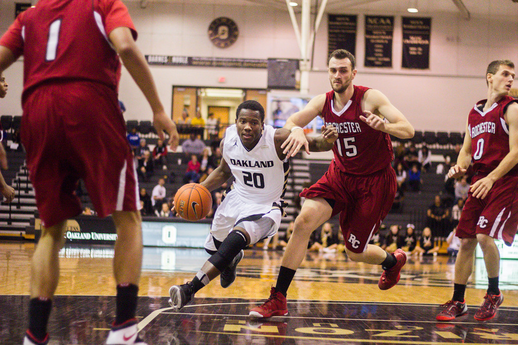 Description of . Felder pushes through the Rochester College defense for a lay-up attempt. Photo by Dylan Dulberg
