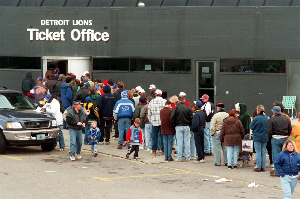 Description of . Lions fans wait in line to buy tickets for the upcoming Thanksgiving Day game against the Pittsburgh Steelers at the Silverdome.