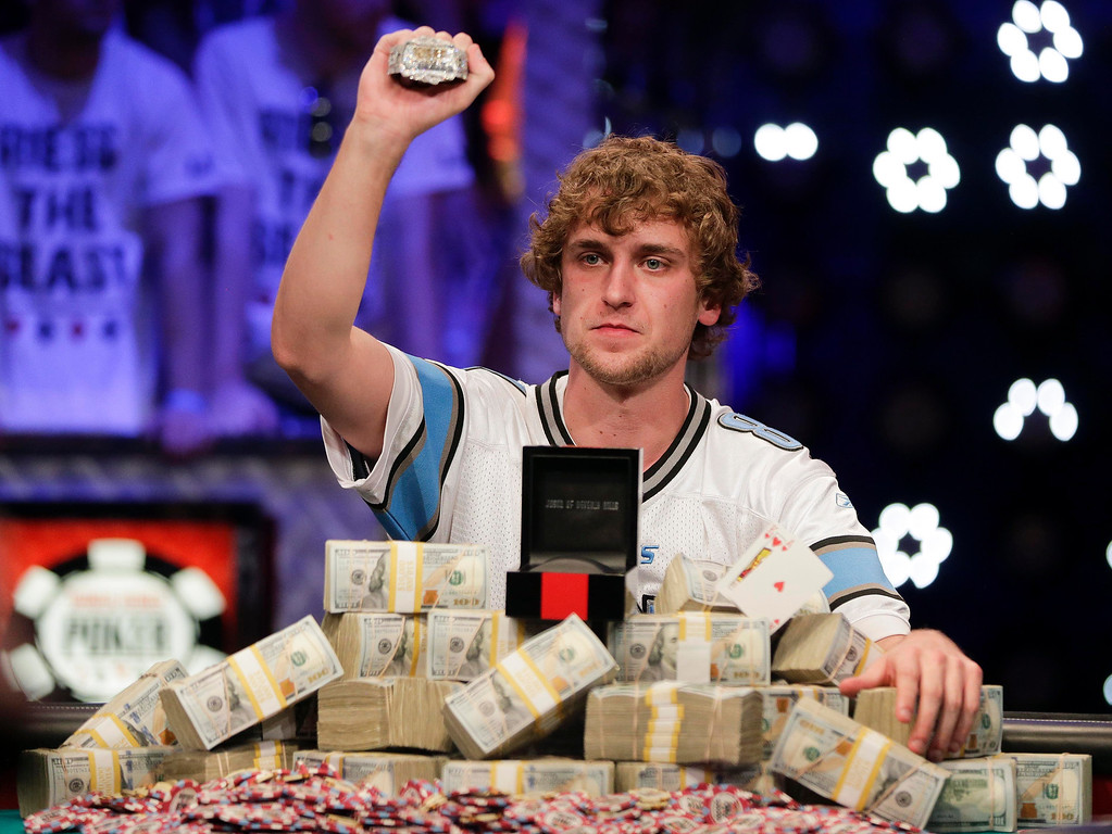 Description of . Ryan Riess holds up the championship bracelet after defeating Jay Farber for the $8.4 million payout in the World Series of Poker Final Table, Tuesday, Nov. 5, 2013, in Las Vegas. (AP Photo/Julie Jacobson)