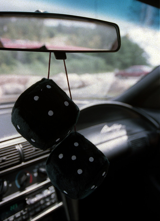 Description of . Fuzzy Dice on rear view mirror for Dream Cruise coverage.