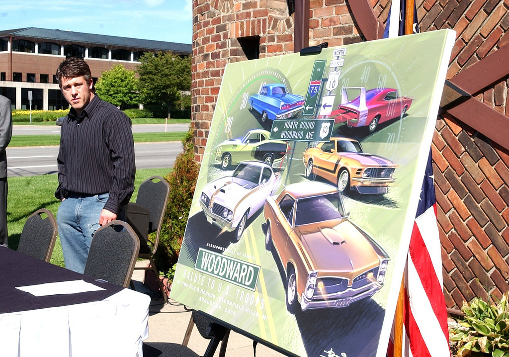 """Description of . Artist Jason Bliss of Orion Twp. at the unveiling of his poster for the 2005 Dream Cruise  \""""Salute To The Troops\"""" at the Fox and Hounds restaurant in Bloomfiled Hills.  The third annual cruise poster proceeds go to Michigan Nation Guard Family Fund."""