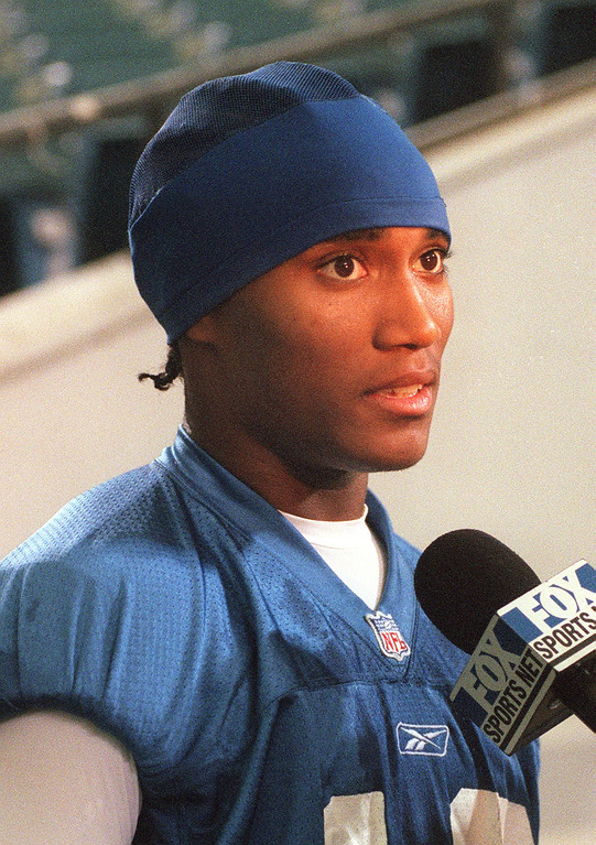 . Detroit Lions wide receiver and draft pick Scotty Anderson (#18) gets interviewed after minicamp, held inside the Silverdome in Pontiac, Mich., Friday, June 1, 2001.