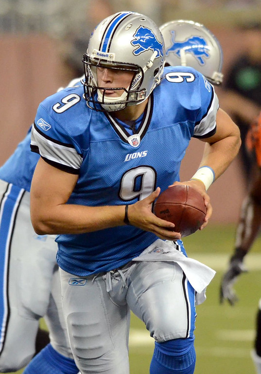 . Detroit Lions QB Matthew Stafford rolls out of the pocket during their preseason game against the Cincinnati Bengals at Ford Field, Friday August 12, 2011. (Oakland Press Photo By: Vaughn Gurganian)