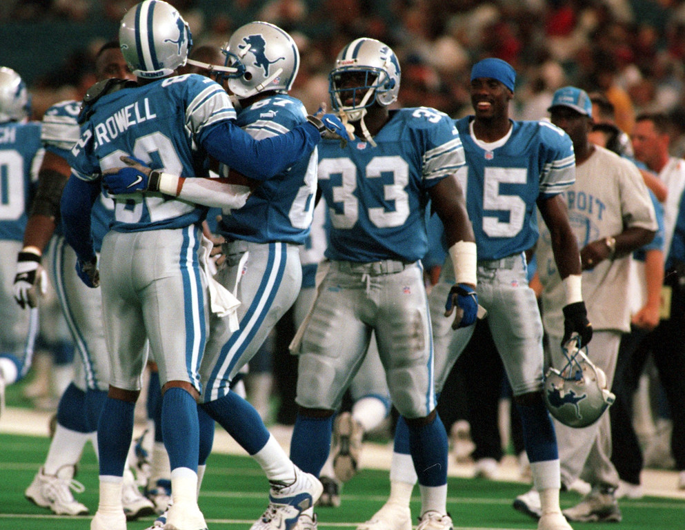 . Germane Crowell (82) of the Detroit Lions celebrates with teammates after scoring a touchdown in the first half during Friday night\'s preseason home opener against the Cincinnati Bengals.