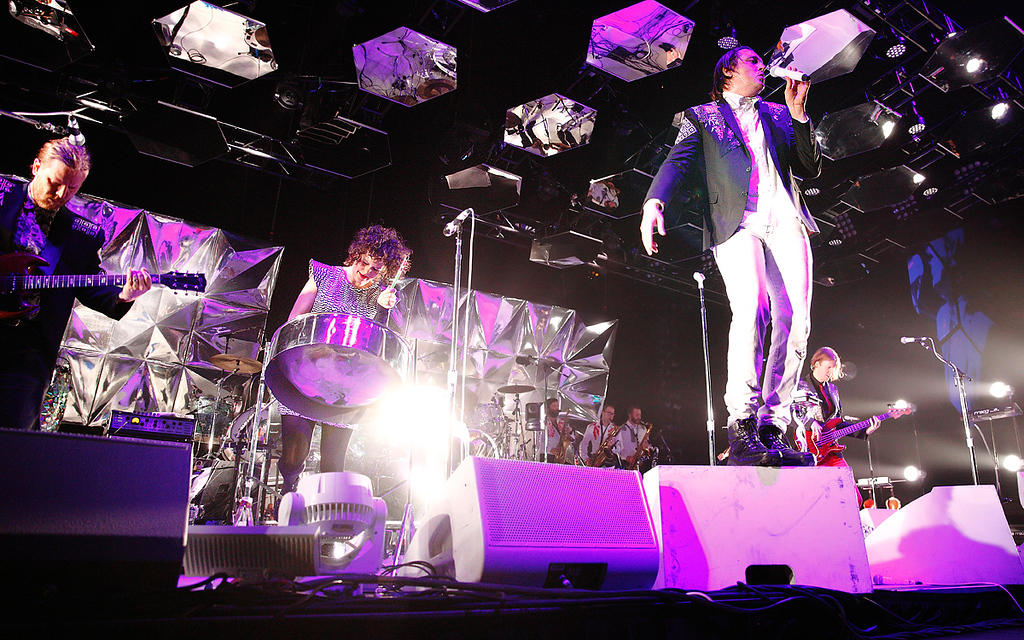 Description of . Regene Chassagne, Win Butler and Arcade Fire perform at The Palace on March 10, 2014. Photo by Ken Settle