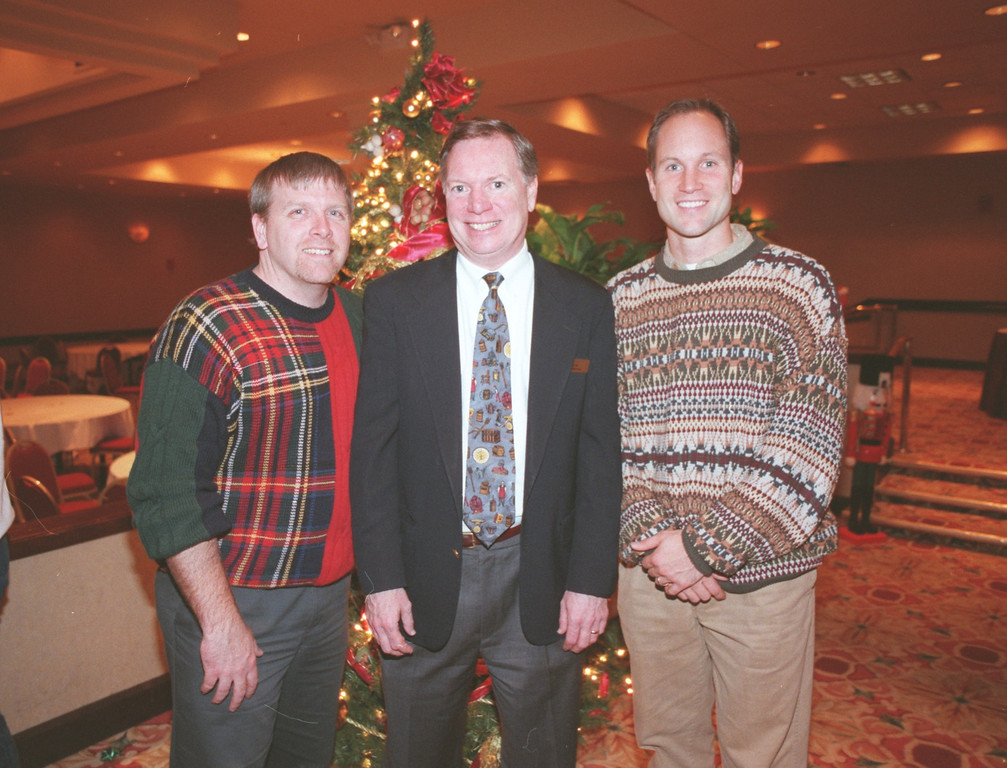 . Pictured (L-R): Gordie Lindsay, founder and executive director for Providence Youth Outreach; Patrick Tinetti, Director of Marketing for the Troy Marriott hotel; Jason Hanson, kicker for the Detroit Lions.  They were at a x-mas party for Providence Youth Outreach held at the Troy Marriott Hotel in Troy, Mich.