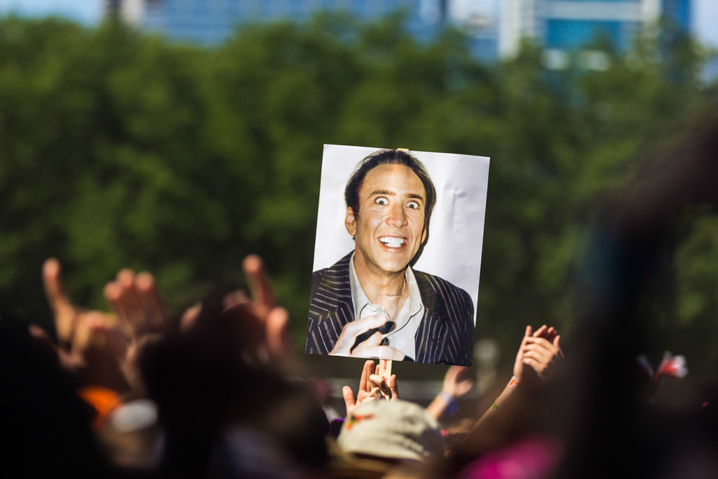 Description of . Fans brought all kinds of things with them, like this particularly unnerving picture of actor Nicolas Cage.