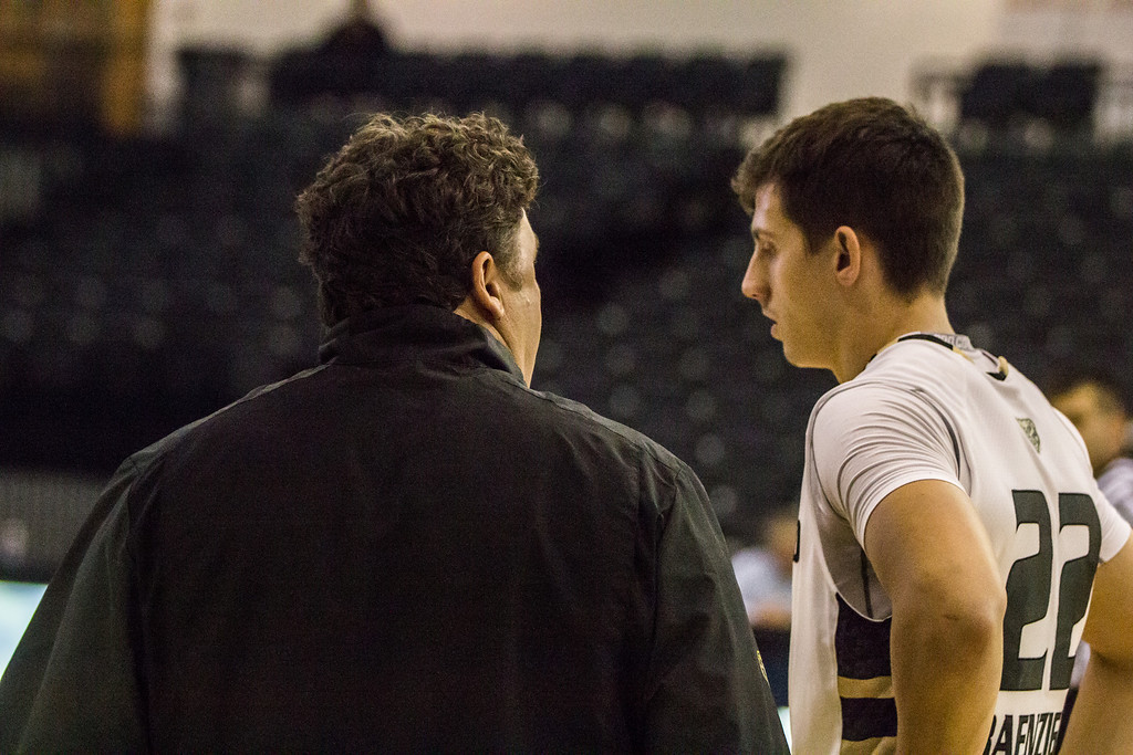 Description of . Oakland coach Greg Kampe talks to guard Mitch Benzinger near the end of the first half Tuesday, Oct. 29, 2013 at the Athletics Center O'rena. Photo by Dylan Dulberg